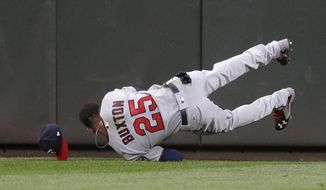 Minnesota Twins center fielder Byron Buxton lands after making a leaping catch of a line drive hit by Seattle Mariners' Robinson Cano during the fifth inning of a baseball game, Thursday, June 8, 2017, in Seattle. (AP Photo/Ted S. Warren)