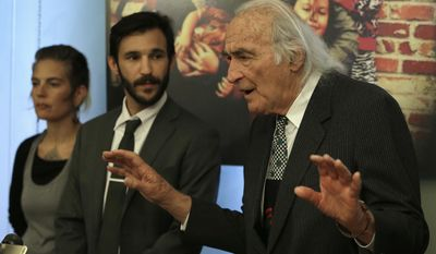 Tony Serra, right, gestures beside Jeffrey Krasnoff, both attorneys representing Derick Almena, during a media conference on Friday, June 9, 2017, in San Francisco. Almena, the operator of an Oakland warehouse where 36 people died in a massive fire, is experiencing a near mental breakdown following his arrest on involuntary manslaughter charges, his attorneys said Friday. Micah Allison, wife of Derick Almena, is seen at left. (AP Photo/Ben Margot)