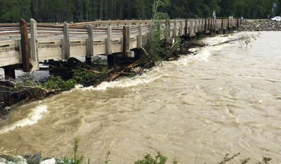 This photo provided by Teton County shows flooding that has closed Cattleman's Bridge on Spring Gulch Road over the Gros Ventre River north of Jackson, Wyo., seen Friday, June 9, 2017. Authorities said the current level and speed of the river has structurally compromised the structure, and it is currently unsafe for passage. High runoff has flooded many streams and rivers in central and western Wyoming. (Teton County via AP)