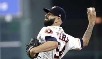 Houston Astros starting pitcher Mike Fiers throws against the Los Angeles Angels during the fourth inning of a baseball game Saturday, June 10, 2017, in Houston. (AP Photo/David J. Phillip)
