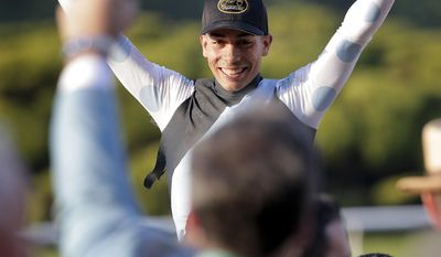 Jose Ortiz celebrates after riding Tapwrit to victory in the 149th running of the Belmont Stakes horse race, Saturday, June 10, 2017, in Elmont, N.Y. (AP Photo/Peter Morgan)
