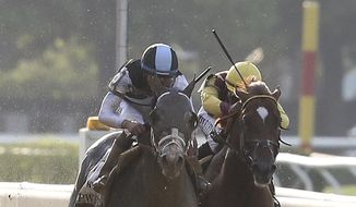 Tapwrit, left, and Irish War Cry race to the finish during the 149th running of the Belmont Stakes horse race, Saturday, June 10, 2017, in Elmont, N.Y. Tapwrit won the race. (AP Photo/Mary Altaffer)