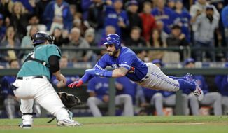 Toronto Blue Jays' Kevin Pillar dives for the plate but is tagged out by Seattle Mariners catcher Mike Zunino during the seventh inning of a baseball game, Friday, June 9, 2017, in Seattle. (AP Photo/John Froschauer)