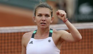 Romania's Simona Halep clenches her fist after defeating Karolina Pliskova of the Czech Republic during their semifinal match of the French Open tennis tournament at the Roland Garros stadium, Thursday, June 8, 2017 in Paris. (AP Photo/David Vincent)