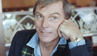 FILE - In this Dec. 11, 1985 file photo, Adam West poses for a photo in Los Angeles. On Saturday, June 10, 2017, his family said the actor, who portrayed Batman in a 1960s TV series, has died at age 88. (AP Photo/Lennox McLendon, File)