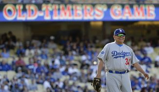 Former Los Angeles Dodgers pitcher Fernando Valenzuela smiles first during the first inning of an old-timers baseball game in Los Angeles, Saturday, June 10, 2017. (AP Photo/Chris Carlson)