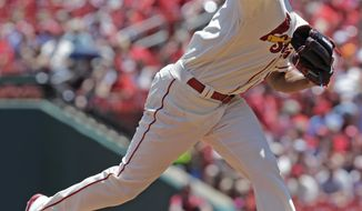 St. Louis Cardinals starting pitcher Carlos Martinez delivers a pitch in the first inning of a baseball game against the Philadelphia Phillies, Saturday, June 10, 2017, in St. Louis. (AP Photo/Tom Gannam)