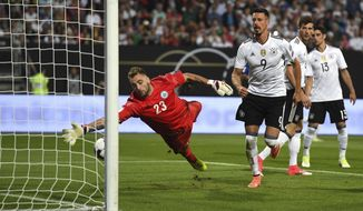 Goalie Elia Benedettini of San Marino is unable to stop Mustafi of Germany's goal for 5:0 during the World Cup qualifier Group C soccer match between Germany and San Marino at the Stadion Nuernberg in Nuremberg, Germany, Saturday June 10, 2017. (Peter Kneffel/dpa via AP)