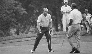 FILE - In this June 18, 1967, file photo, Jack Nicklaus picks up his ball from the 18th green after winning the U.S. Open golf tournament as second placed Arnold Palmer, right, looks on at Baltusrol golf club in Springfield, N.J. Nicklaus made birdie for 275, breaking Ben Hogan's U.S. Open record that had stood since 1948. (AP Photo/File)
