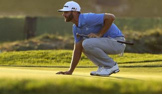 FILE - In this June 17, 2016, file photo, Dustin Johnson lines up his putt on the seventh hole during the rain delayed second round of the U.S. Open golf championship at Oakmont Country Club, in Oakmont, Pa. Dustin Johnson had the perfect temperament to handle such a mental test last year at Oakmont when he won the U.S. Open. (AP Photo/Charlie Riedel, File)