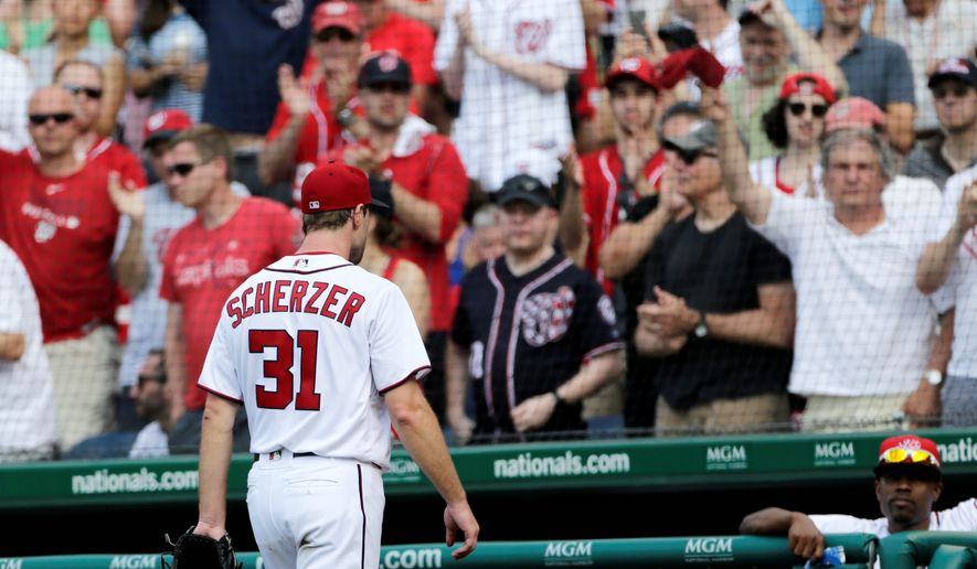 Fans salute Washington Nationals starting pitcher Max Scherzer after he is relieved in the eighth inning of Sunday's 5-1 loss to the Texas Rangers. (Associated Press Photographs)