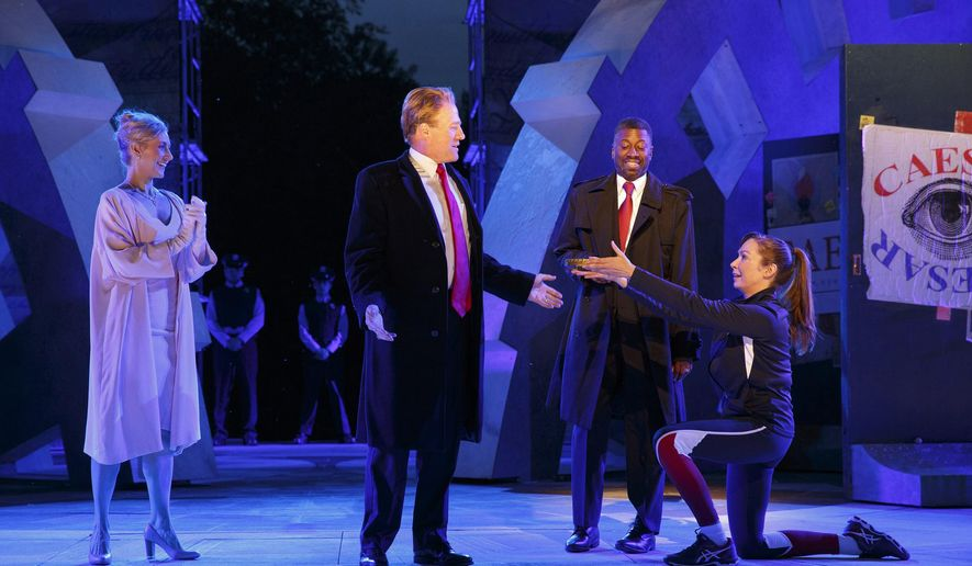 In this May 21, 2017 photo provided by The Public Theater, Tina Benko, left, portrays Melania Trump in the role of Caesar's wife, Calpurnia, and Gregg Henry, center left, portrays President Donald Trump in the role of Julius Caesar during a dress rehearsal of The Public Theater's Free Shakespeare in the Park production of Julius Caesar, in New York. Rounding out the cast on stage is Teagle F. Bougere as Casca, and Elizabeth Marvel, right, as Marc Anthony. (Joan Marcus/The Public Theater via AP)