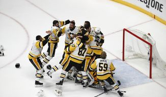 Pittsburgh Penguins players celebrate after defeating Nashville Predators 2-0 in Game 6 of the NHL hockey Stanley Cup Final, Sunday, June 11, 2017, in Nashville, Tenn. (AP Photo/Jeff Roberson)