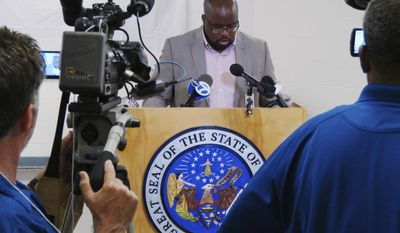 FILE - In this April 24, 2017, file photo, Arkansas prison department spokesman Solomon Graves speaks to reporters amid a series of executions at the Cummins Unit prison at Varner, Arkansas. Additional arguments over whether the state's three-drug execution protocol are expected if the state sets more execution dates or when a federal judge resumes a hearing on a claim by surviving inmates that they're at a risk for cruel or unusual punishment. (AP Photo/Kelly P. Kissel, File)