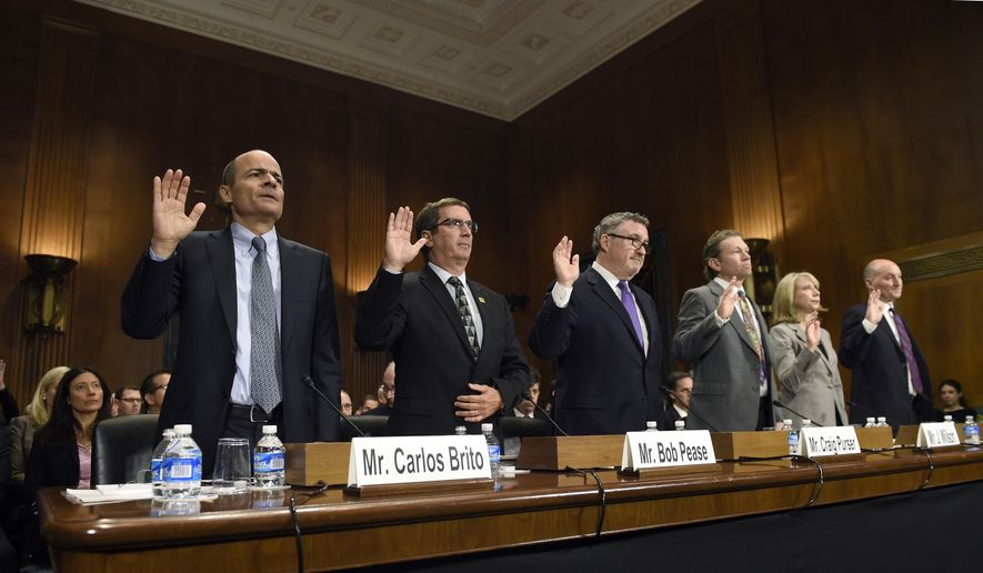 From left, Anheuser-Busch InBev Chief Executive Officer Carlos Brito, Brewers Association Chief Executive Officer Bob Pease, National Beer Wholesalers Association President and Chief Executive Officer Craig Purser, Iowa Brewers Guild Minister of Iowa Beer J. Wilson, American Antitrust Institute President Diana Moss, and Molson Coors President and Chief Executive Officer Mark Hunter, are sworn in to testify before the Senate Antitrust, Competition Policy and Consumer Rights Subcommittee on Capitol Hill in Washington, Tuesday, Dec. 8, 2015, during a hearing on world's two biggest beer makers, AB InBev and SABMiller, deal to join forces to create a company that produces almost a third of the world's beer. (AP Photo/Susan Walsh)