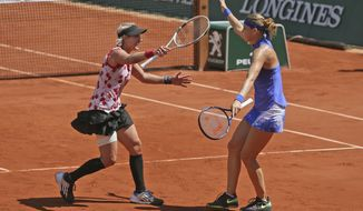 Bethanie Mattek-Sands of the U.S., left, and Lucie Safarova of the Czech Republic celebrate winning women's doubles final match against Australia's Ashleigh Barty and Casey Dellacqua in two sets 6-2, 6-1, at the French Open tennis tournament at the Roland Garros stadium, in Paris, France, Sunday, June 11, 2017. (AP Photo/David Vincent)