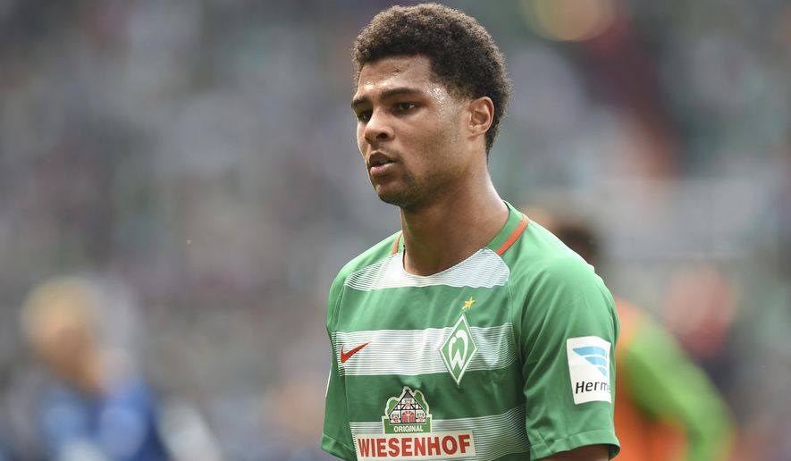 FILE - In this May 13, 2017 file photo Werder Bremen's Serge Gnabry attends the Bundesliga soccer matcht against TSG Hoffenheim in Bremen, Germany. According to German dpa news agency, on Sunday, June 11, 2017  Bayern Munich have signed  Serge Gnabry from Werder Bremen.  ( Carmen Jaspersen/dpa via AP,file)