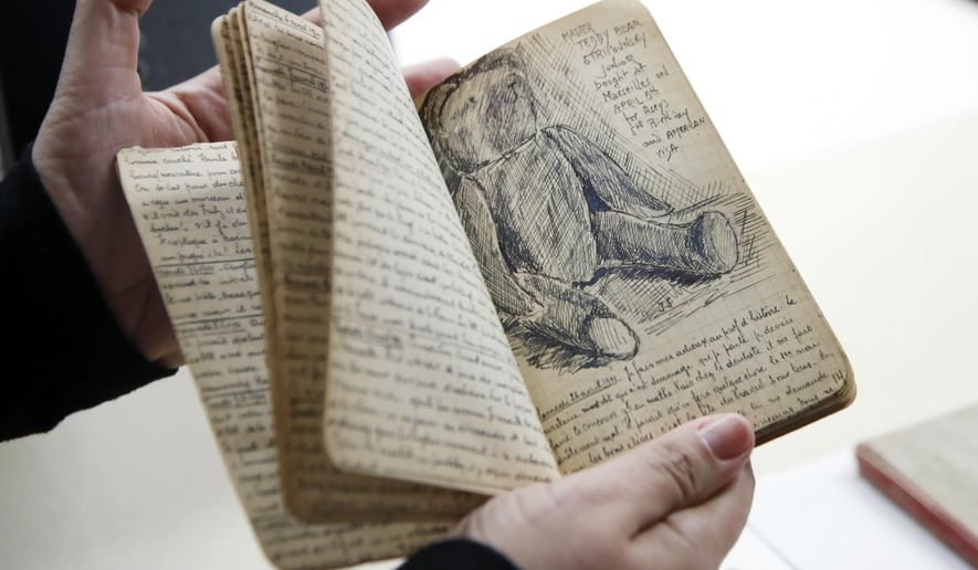 "A page of Joseph Stripounsky's diary with a sketch showing ""Master Teddy Bear,""  is shown at the Holocaust Memorial Museum in Washington, Wednesday, June 7, 2017. The U.S. Holocaust Memorial Museum is launching its first-ever crowd-funding campaign in an effort to preserve and digitize more than 200 diaries from Holocaust victims and survivors. (AP Photo/Manuel Balce Ceneta)"