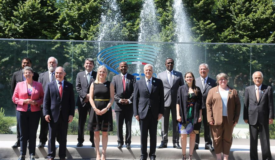 Environment ministers, European Union representatives and outreach partners pose for a family photo at the opening of a two-day G7 summit on the environment, in Bologna, Italy, Sunday, June 11, 2017. Front row from left; German Federal Minister for the Environment Barbara Hendricks, United States Environment Protection Agency chief Scott Pruitt, Canada's Environment Minister Catherine McKenna, Italian Environment Minister Gian Luca Galletti, France's Environment expert Virginie Dumoulin, Britain's Department for Environment Food & Rural Affairs minister Therese Coffey, Japanese Environment Minister Koichi Yamamoto. Back row from left; Maldives Environment Minister Thoriq Ibrahim, European Commissioner for Cimate, Miguel Arias Canete, Chile Environment Minister Marcelo Mena Carrasco, unidentified, Rwanda's Minister of Natural Resources Vincent Biruta and European Union Commissioner for the Environment Karmenu Vella  (Giorgio Benvenuti/ANSA via AP)