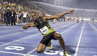 "Jamaica's Usain Bolt celebrates after winning the ""Salute to a Legend "" 100 meters during the Racers Grand Prix at the national stadium in Kingston, Jamaica, Saturday, June 10, 2017. Bolt started his final season with his last race on Jamaican soil and plans to retire from track and field after the 2017 London World Championships in August. (AP Photo/Bryan Cummings)"