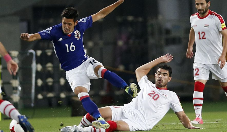 Japan's Hotaru Yamaguchi, left, and Syria's Khaled Almbayed vie for the ball during their Kirin Challenge Cup international friendly soccer match against Japan in Tokyo, Wednesday, June 7, 2017.(AP Photo/Shuji Kajiyama)