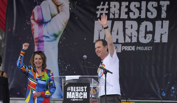 Rep. Adam B. Schiff joined House Minority Leader Nancy Pelosi, a fellow California Democrat, at a rally last year. Mr. Schiff will be given unilateral subpoena power in January and has promised renewed vigor in investigating President Trump. (Associated Press/File)