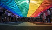 Marchers unfurl a huge rainbow flag as they prepare to march in the Equality March for Unity and Pride in Washington, Sunday, June 11, 2017. (AP Photo/Carolyn Kaster) ** FILE **