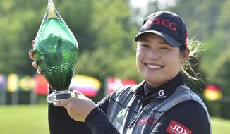Ariya Jutanugarn of Thailand holds the winner's trophy after winning a playoff to win the Manulife LPGA Classic at Whistle Bear Golf Club in Cambridge, Ontario on Sunday June 11, 2017. (Frank Gunn/The Canadian Press via AP)