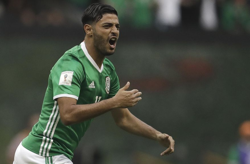 Mexico's Carlos Vela celebrates after scoring his team's first goal against the U.S. during their World Cup soccer qualifying match at Azteca Stadium in Mexico City, Sunday, June 11, 2017.(AP Photo/Rebecca Blackwell)