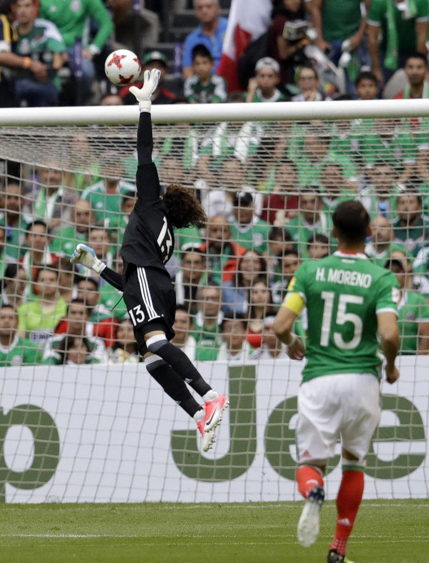 Mexico's goalkeeper Guillermo Ochoa tries to reach the ball as United States' Michael Bradley scores during their World Cup soccer qualifying match at Azteca Stadium in Mexico City, Sunday, June 11, 2017.(AP Photo/Rebecca Blackwell)