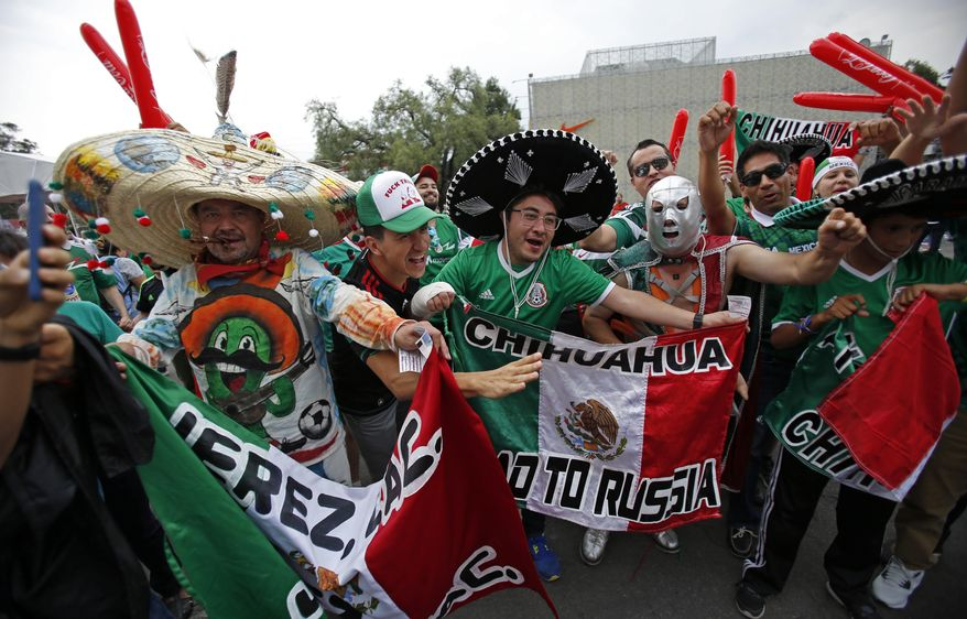 Mexico's fans cheer as they arrive for a World Cup soccer qualifying match between mexico and the U.S. at Azteca Stadium in Mexico City, Sunday, June 11, 2017.(AP Photo/Rebecca Blackwell)