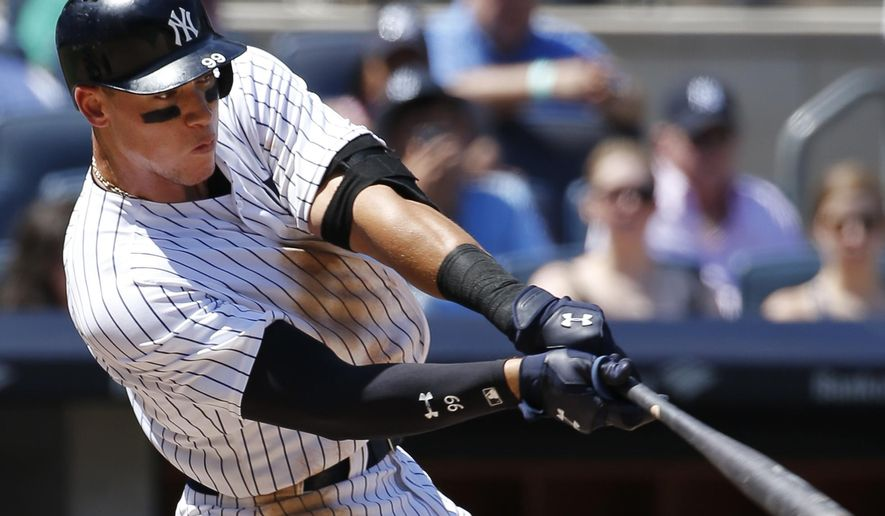 New York Yankees' Aaron Judge hits a double during the fourth inning of a baseball game against the Baltimore Orioles in New York, Sunday, June 11, 2017. (AP Photo/Kathy Willens)