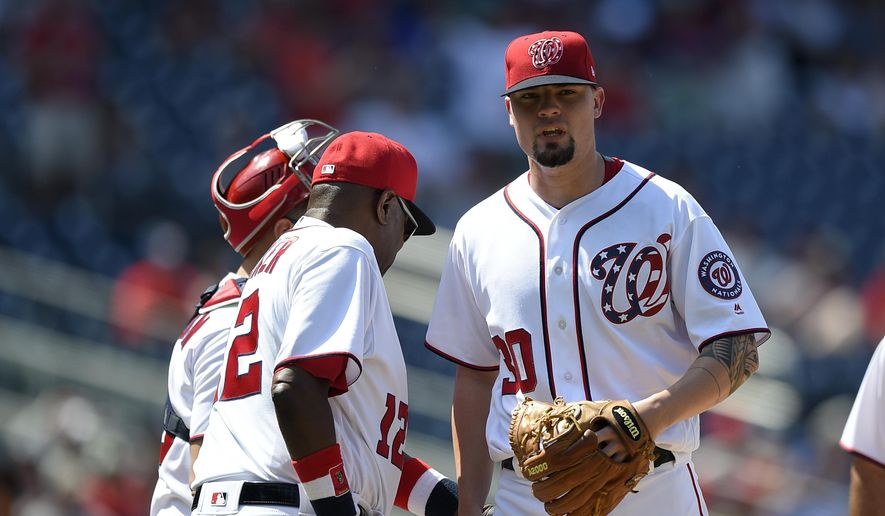 Washington Nationals relief pitcher Koda Glover, right, is pulled from a baseball game by Dusty Baker, left, during the ninth inning against the Texas Rangers, Saturday, June 10, 2017, in Washington. (AP Photo/Nick Wass)