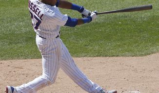 Chicago Cubs' Addison Russell hits a solo home run during the sixth inning of a baseball game against the Colorado Rockies, Sunday, June 11, 2017, in Chicago. (AP Photo/Nam Y. Huh)
