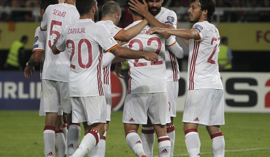 Spain's Diego Costa, second right, celebrates scoring against Macedonia with teammates during their World Cup Group G qualifying soccer match at the Philip II National Stadium in Skopje, Macedonia, on Sunday, June 11, 2017. (AP Photo/Boris Grdanoski)