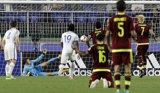 England goalkeeper Freddie Woodman,second left, saves a penalty during the final against Venezuela of the FIFA U-20 World Cup Korea 2017 at Suwon World Cup Stadium in Suwon, South Korea, Sunday, June 11, 2017. (AP Photo/Ahn Young-joon)