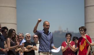 Manchester City coach Pep Guardiola gestures after delivering a speech during a protest organised by the National Assembly for Catalonia, to support the call for referendum in Barcelona, Spain, Sunday, June 11, 2017. On Friday, Catalonia's regional president Carles Puigdemont announced that his government would hold the independence referendum on Oct. 1. Spain's government has promised to not allow the vote on grounds that is unconstitutional since it is matter that would affect all Spaniards. (AP Photo/Emilio Morenatti)
