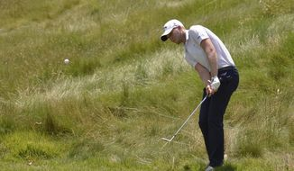 Daniel Berger hits from the edge of the rough on the first hole during the final round of the St. Jude Classic golf tournament Sunday, June 11, 2017, in Memphis, Tenn. (AP Photo/Brandon Dill)