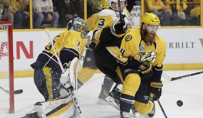 Nashville Predators' Ryan Ellis (4) and goalie Pekka Rinne (35), of Finland, defend the goal against Pittsburgh Penguins' Olli Maatta (3), of Finland, during the second period of Game 6 of the NHL hockey Stanley Cup Final, Sunday, June 11, 2017, in Nashville, Tenn. (AP Photo/Mark Humphrey)