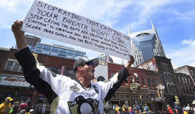 Pittsburgh Penguins fan Sonny Carlisle taunts Nashville Predators fans Sunday, June 11, 2017, before Game 6 of the NHL hockey Stanley Cup final at Bridgestone Arena in Nashville, Tenn. (Peter Diana/Pittsburgh Post-Gazette via AP)