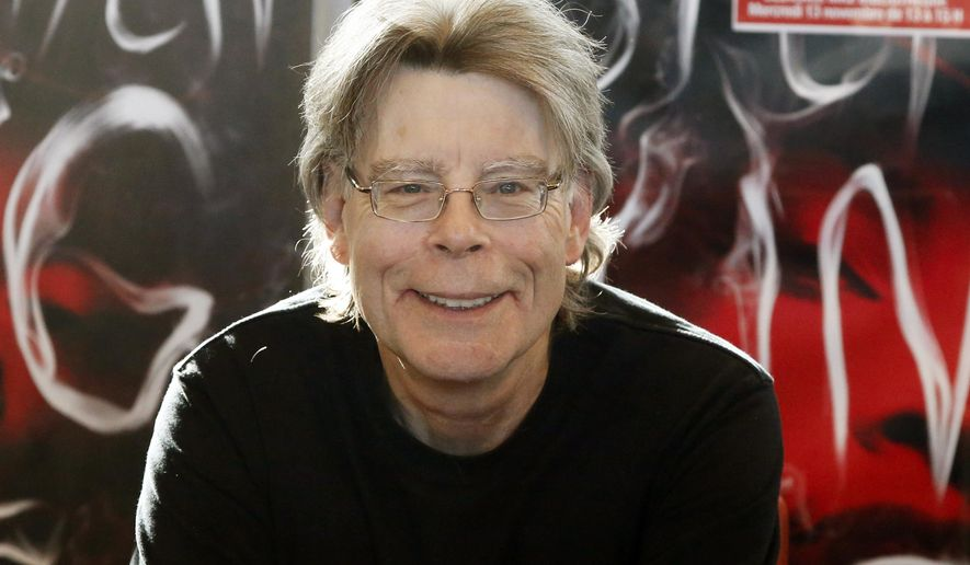 FILE - In this Nov. 13, 2013 file photo, author Stephen King poses for the cameras, during a promotional tour in Paris. Professor Caroline Bicks, a Shakespeare scholar who grew up reading Stephen King books, will hold a University of Maine position named in honor of the Maine horror author. (AP Photo/Francois Mori, File)