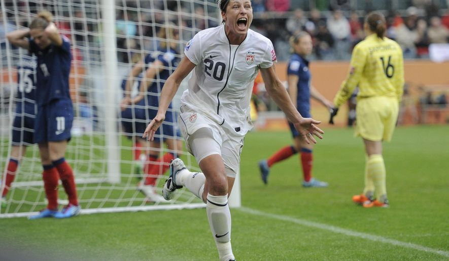 """FILE - In this July 13, 2011, file photo, United States' Abby Wambach celebrates scoring her side's second goal during a semifinal match against France at the Women's Soccer World Cup in Moenchengladbach, Germany. Wambach is astonished when she reflects on the year she's had. She went from admitting a problem with alcohol and prescription pills to getting sober and marrying a """"Christian mommy blogger."""" The biggest stunner? She doesn't miss soccer a bit.(AP Photo/Martin Meissner, File)"""
