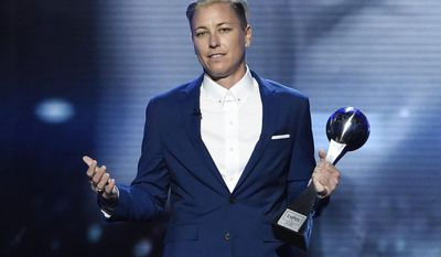 """FILE - In this Wednesday, July 13, 2016, file photo, former soccer player Abby Wambach, accepts the icon award at the ESPY Awards at the Microsoft Theater in Los Angeles. Wambach is astonished when she reflects on her year. She went from publicly acknowledging a problem with alcohol and prescription pills to getting sober and marrying a """"Christian mommy blogger."""" The biggest stunner? She doesn't miss soccer a bit. (Photo by Chris Pizzello/Invision/AP, File)"""