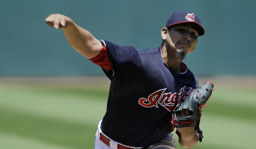 Cleveland Indians starting pitcher Carlos Carrasco delivers in the first inning of a baseball game against the Chicago White Sox, Sunday, June 11, 2017, in Cleveland. (AP Photo/Tony Dejak)