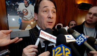In this file photo, New York Islanders' general manager Mike Milbury talks to the media after team owner Charles Wang announced that Milbury will step aside as general manager after a replacement is found, during a news conference in Uniondale, N.Y., Thursday, Jan. 12, 2006. Milbury is now a hockey analyst for NBC Sports. (AP Photo/Henny Ray Abrams)