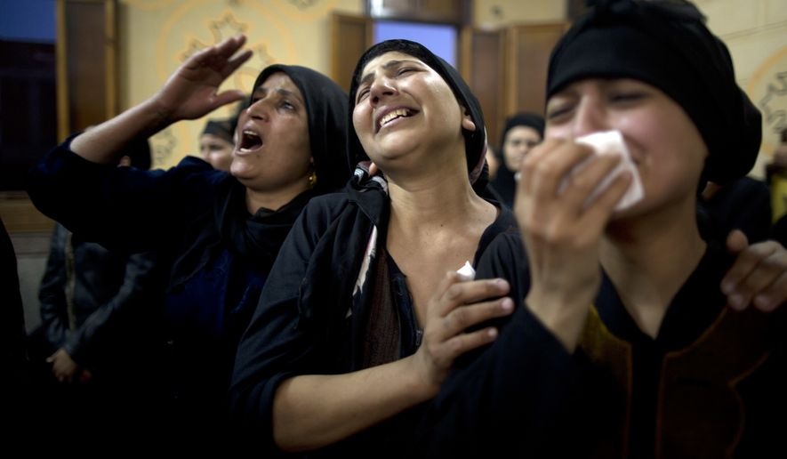 Coptic Christians grieve for the 29 Copts killed in an Islamic State ambush of their bus on a trip to volunteer at a monastery. (Associated Press/File)