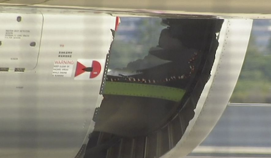 In this image made from video, a hole is seen in the engine of China Eastern airlines Flight 736 after it landed in Sydney, Australia, Monday, June 12, 2017. China Eastern said the crew on Flight 736 noticed damage to the air inlet on the left engine after takeoff Sunday evening and the captain decided to return. (Australian Broadcasting Corporation via AP)