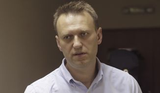 Russian opposition leader Alexei Navalny was arrested Monday on his way to a protest over accusations that Prime Minister Dmitry Medvedev had accepted over $1 billion in bribes from state banks and Kremlin-friendly oligarchs. (Associated Press)