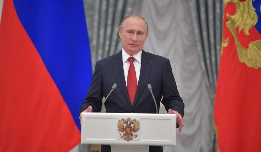 According to the details released by lawmakers, the new legislation would write into law sanctions that were imposed by executive order under the Obama administration, and would give Congress a say should the Trump administration try to lift current penalties. (Alexei Druzhinin/Sputnik, Kremlin Pool Photo via AP) **FILE**