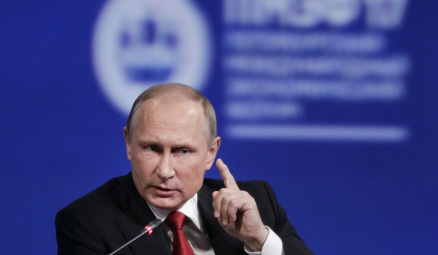 FILE - In this June 2, 2017 file photo, Russian President Vladimir Putin gestures as he speaks at the St. Petersburg International Economic Forum in St. Petersburg, Russia. In a series of interviews with American film director Oliver Stone being shown on U.S. television on Monday, June 12, 2017, Putin said that he inquired about Russia joining NATO when then U.S. President Bill Clinton visited Moscow in 2000. (AP Photo/Dmitry Lovetsky, File)